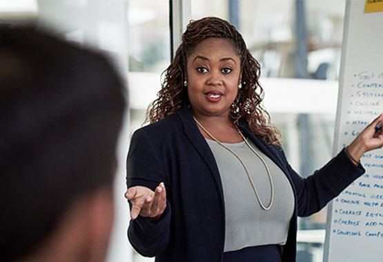 business woman presenting to group